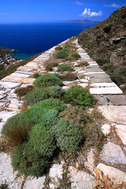 Paved marble alley going down to Isternia bay. Tinos island, Cyclades, Greece