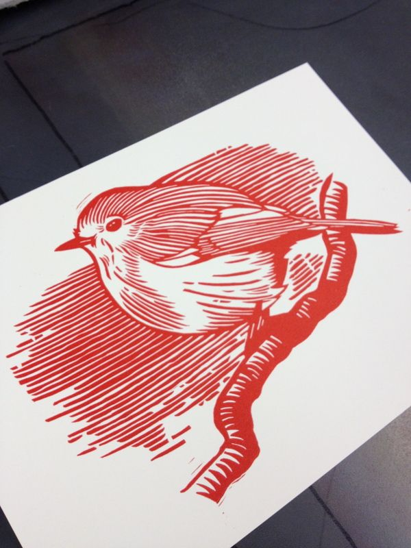 Chubby Robin Linocut by John C Thurbin, via Behance