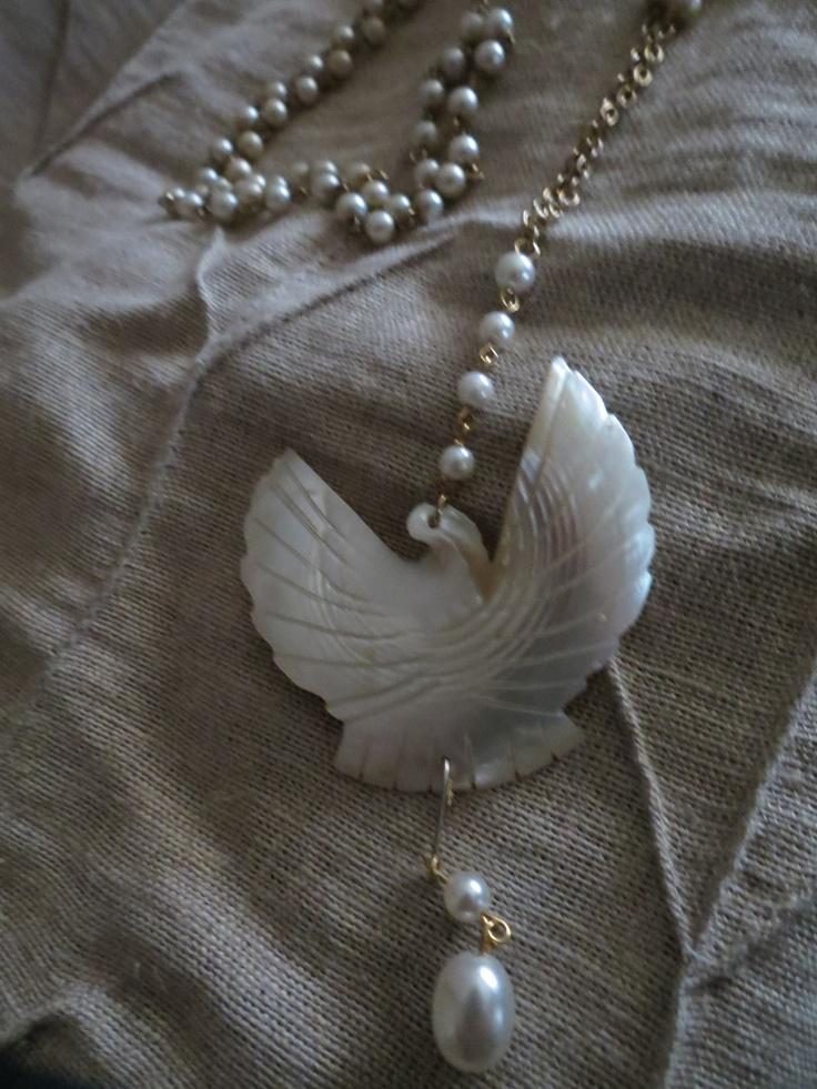 Vintage carved shell dove on vintage pearls