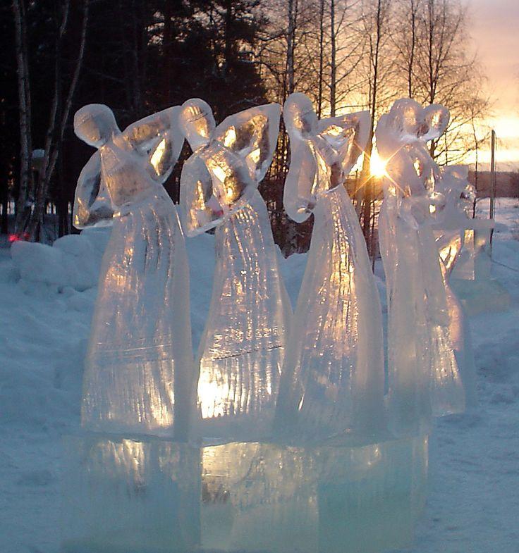 Cold women, golden sun.  Nurmes, Finland.