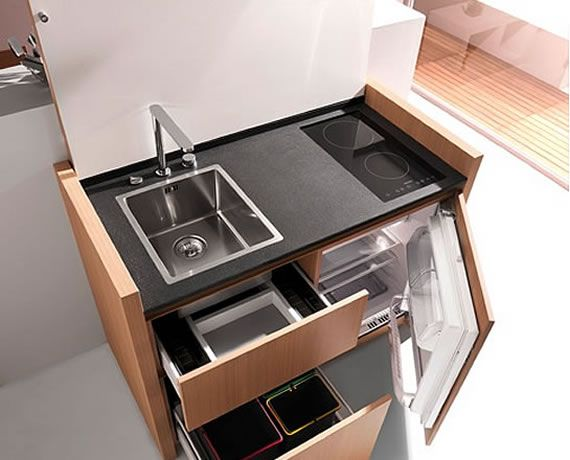 A super compact mini kitchen that looks like a bedroom dresser when closed up. Too cool.
