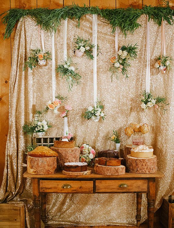 gold sequin backdrop with hanging flowers