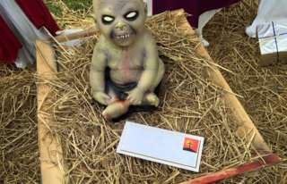 Come on, the Zombie nativity scene is awesome as fuck. The local authorities are being dumbasses.