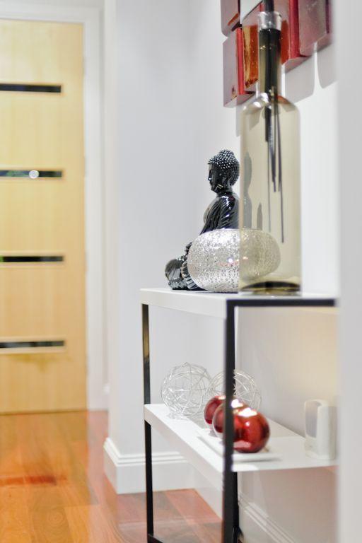 The Range - Custom Designed by Busby Homes. Polished Jarrah floorboards and solid Jarrah & Victorian Ash entry door.