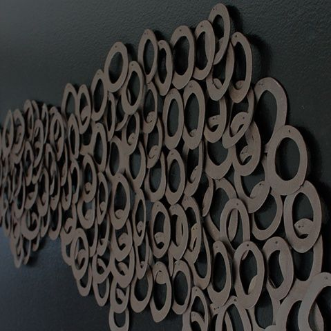 """HALO; Ebb and Flow (detail 2). 42"""" x 102"""" Residential installation. Constructed in black stoneware and fired unglazed to accentuate its natural earthen color and texture. Katherine Dube 2000-2014."""