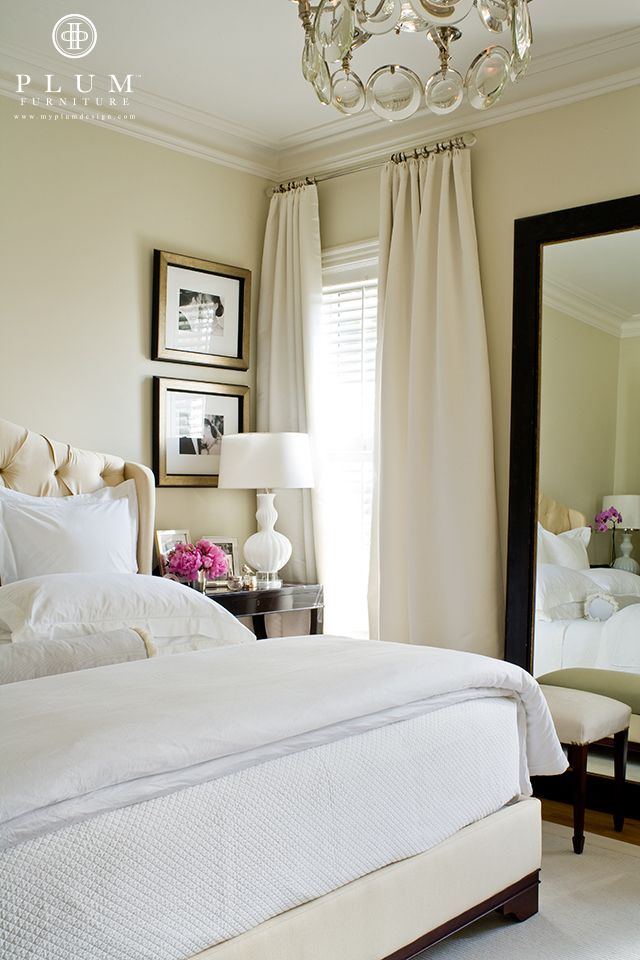 Draperies hung from a glass rod at the ceiling. Corner window. Beautiful elegant room in neutrals.