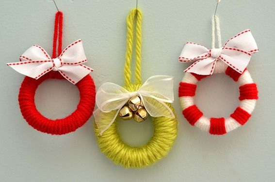 This mini wreath ornament requires few supplies: Yarn.  Ribbon.  And a bathroom decor staple?   Shower curtain rings make this ornament an inexpensive and simple DIY holiday project.  Katie Brown of Smile Like You Mean It grabbed a pack of cheap-o curtain rings and spruced them up with colorful yarn and some creativity.