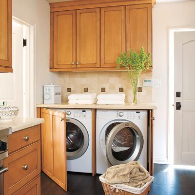 Tucked into the corner of a cooking space and concealed by cabinetry, this laundry area masquerades as a sideboard. | Photo: Joe Schmelzer | thisoldhouse.com