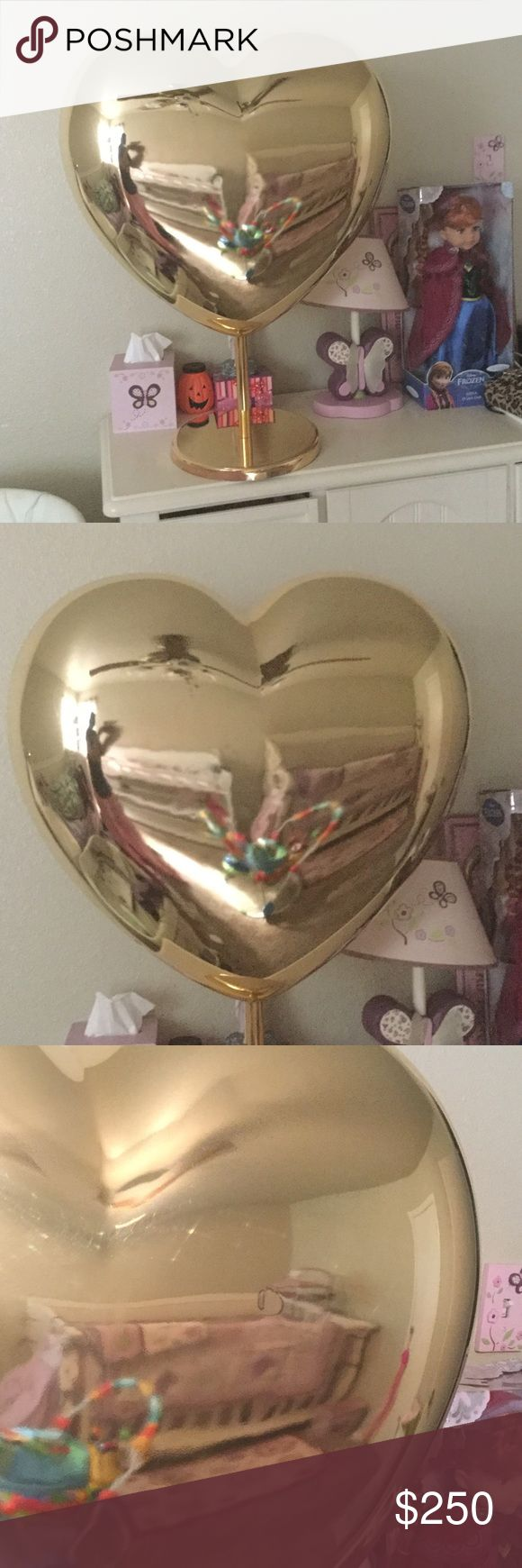 Victoria secret store display gold heart Victoria's Secret pink gold display heart with stand 2 pieces , this display is huge / size , Victoria's Secret prop perfect for a collector , I need to downsize my collection , the heart has minor scuffs/scratches  throughout the heart (they may come off ) and a dime size dent , I tried taking a pic of it but so hard , because of reflection , this item is hard to find not sold in stores at all , sold as is , I'm not in a rush to sell so please no low…