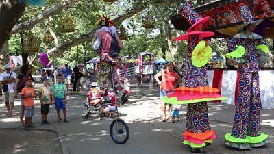 Clowns on stilts and unicycle in Cismigiu park, Bucharest, Romania.