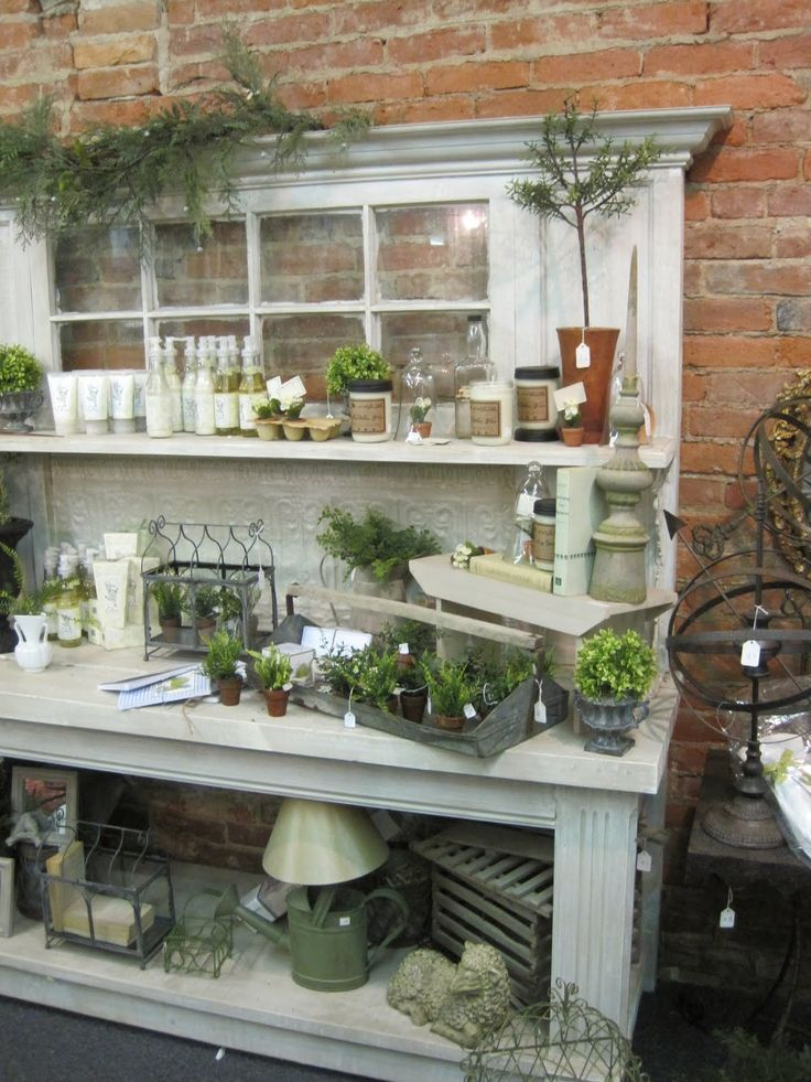 Potting bench with old window and crown molding.