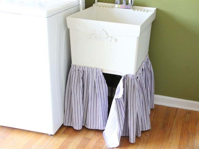 DIY: Laundry Tub Skirt | Momtastic  I have this same tub also. I store extra TP and Papertowels under it. I need to do this! This can add a little cheer to the laundry room.  I may cheat even more and use Valances from the store, if I find cute ones!