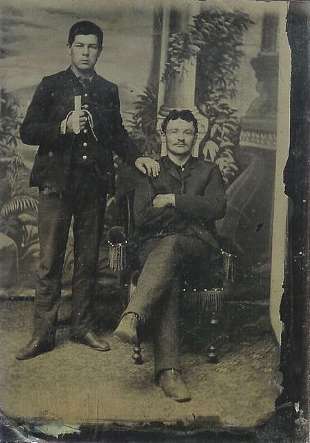 1870-90's, [tintype portrait of two young men, one eating a banana]    The sweet, yellow bananas that we're so familiar with today were introduced in the United States during 1876 Philadelphia Centennial Exposition, selling for ten cents each.