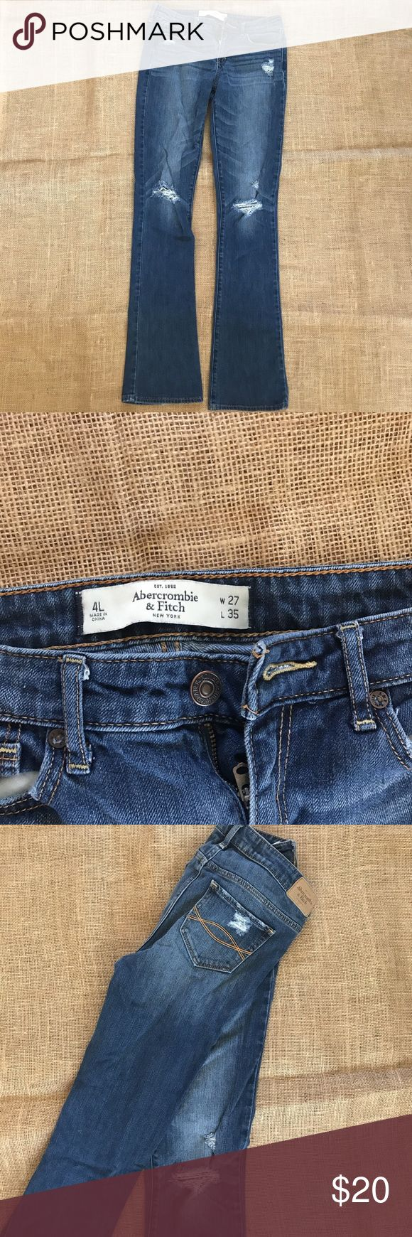 Abercrombie and Fitch Boot Cut Jeans Boot cut jeans with rips in the knees. Size 4L W: 27 L: 35 Abercrombie & Fitch Jeans Boot Cut