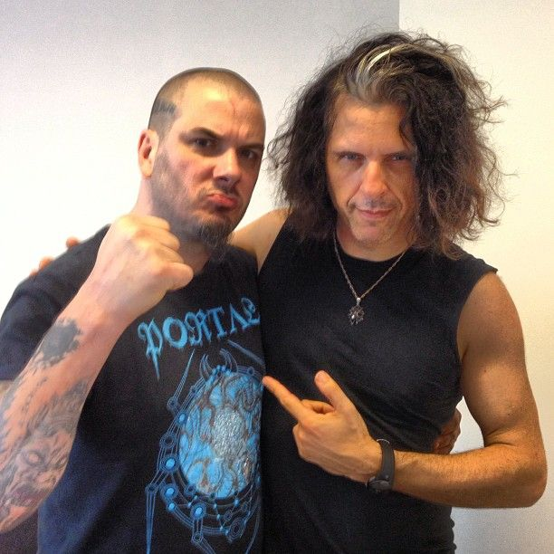 Its futile to try & look menacing while standing next to Phil Anselmo.