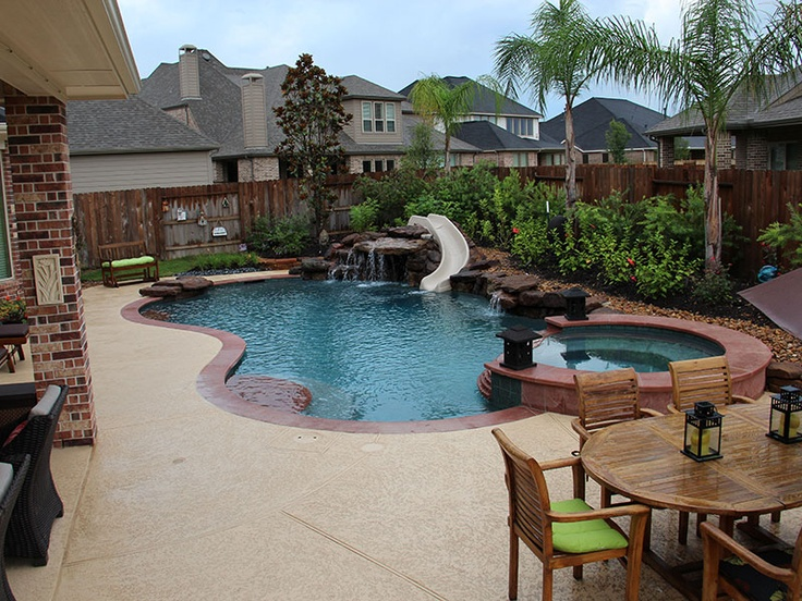 Natural freeform pool with slide and spa