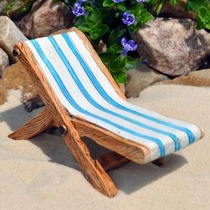 Miniature Lounge Chair Begin creating the Oceanside beach scene, by placing a layer of landscape fabric on top of the soil and spreading white sand generously on top.