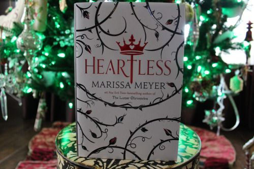 Books and Cupcakes | December Book Photo Challenge Day 8: Wrapping Paper Heartless [Owlcrate Exclusive Cover] by Marissa Meyer. This cover is so gorgeous and I think it would make a good wrapping paper.