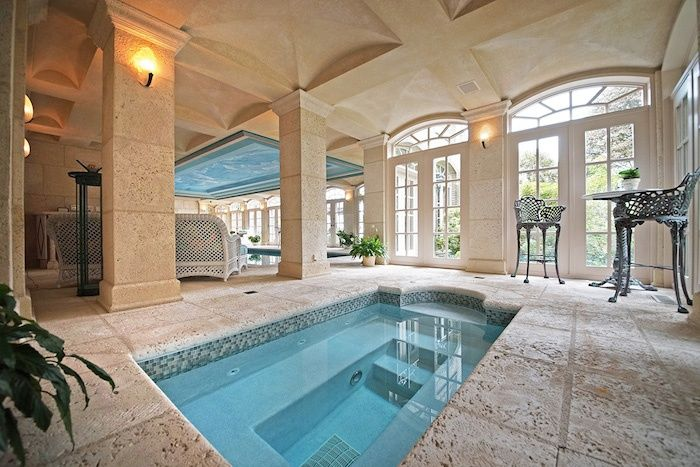 Mediterranean Hot Tub with Stucco ceiling, exterior stone floors, Arched window