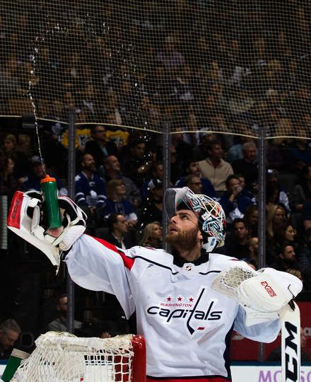 TORONTO, ON - NOVEMBER 25: Braden Holtby #70 of the Washington Capitals squirts water during the second period against the Toronto Maple Leafs at the Air Canada Centre on November 25, 2017 in Toronto, Ontario, Canada. (Photo by Kevin Sousa/NHLI via Getty Images)