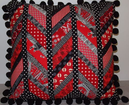 Red and Black Split Chevron cushion. Just one of the possibilities in my Chevron Play Workshop. Uses MM100 Template Set available at pieceville.com.au