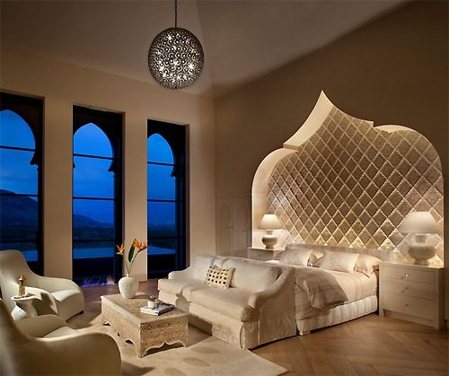 Well that's interesting! Wouldn't have thought a plain white bedroom could be Moroccan inspired but this is gorgeous.