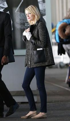 mixed-material jacket + dark skinnies + flats