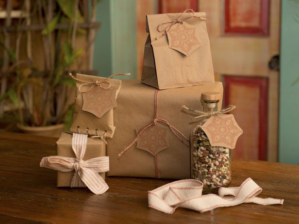 Pretty Ways to Wrap Gifts With Basic Brown Paper >> http://blog.diynetwork.com/maderemade/2013/12/16/4-tips-for-gift-wrapping-with-basic-brown-paper?soc=pinterest