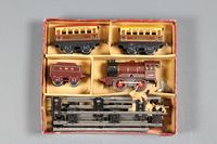 Lot 420 - Hornby, a boxed set comprising a keywind locomotive 500 and LMS tender, 2 Pulman carriages, a quantity of track, an open wagon B, a cement wagon, a barrel wagon, a side tipping wagon, 2 buffer stops a... £200-400