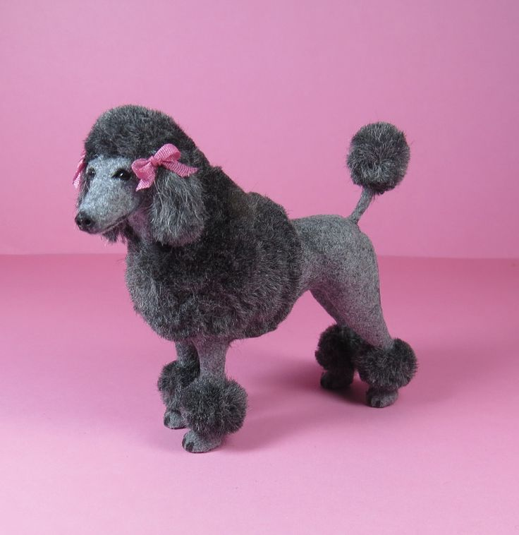 Sculpted and furred French Poodle with a pretty hair cut by Patricia Paul.