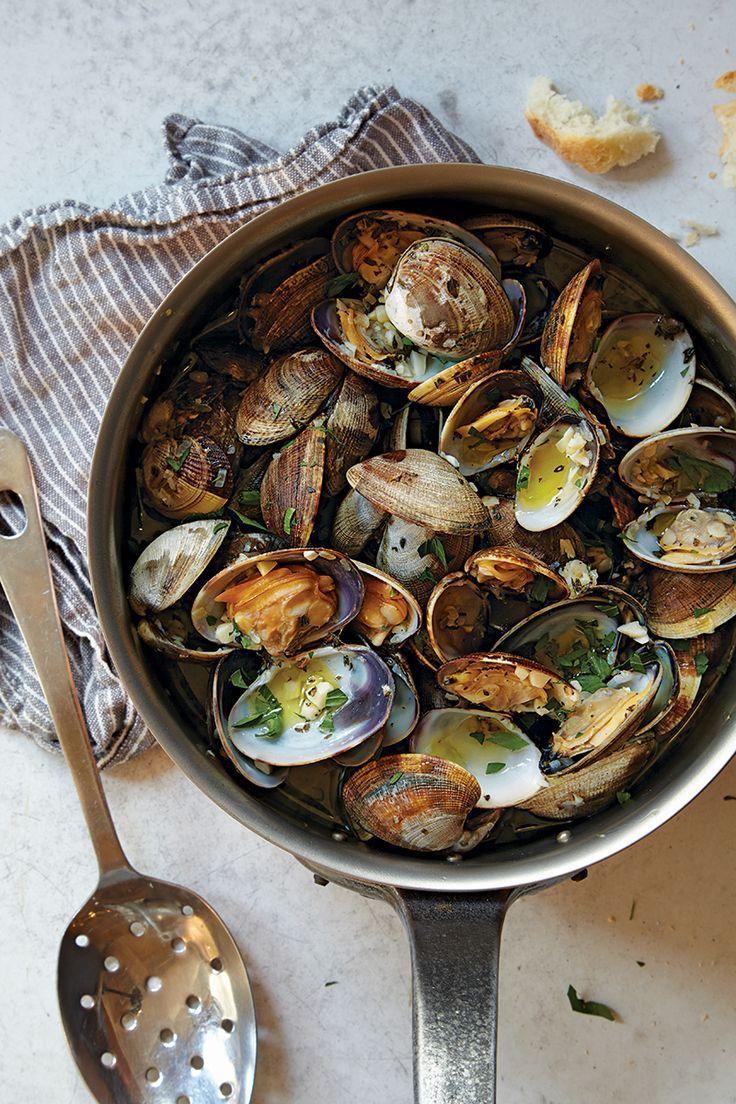 collectorandco:  garlic-steamed manila clams / saveur.com