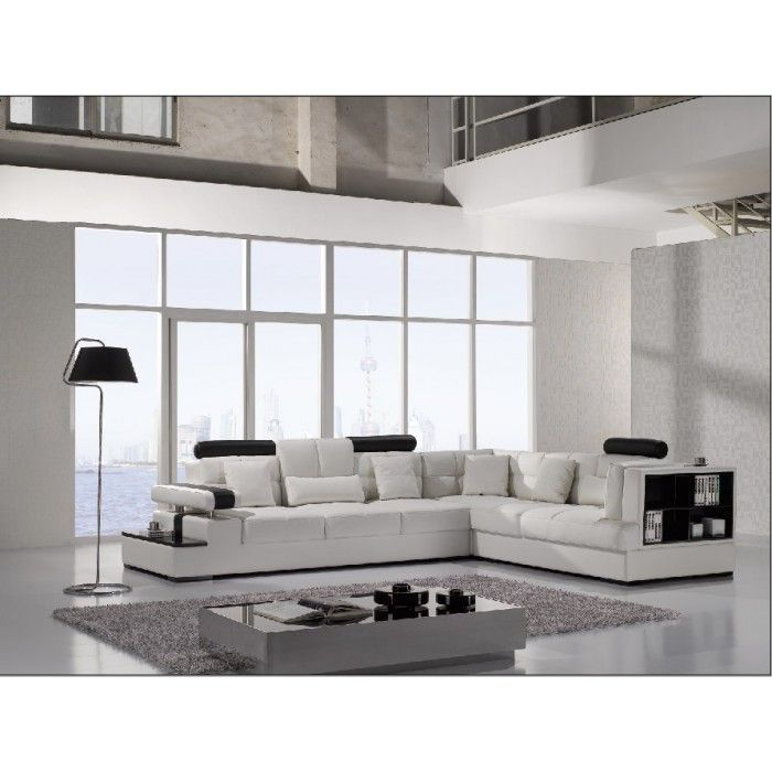 Modern Leather Sectional Sofa with Storage Shelves on one side and end table on the other side.
