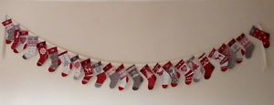 LITTLE-CHRISTMAS-STOCKINGS-ADVENT-CALENDAR-BUNTING-IN-COTTON-HAND-MADE