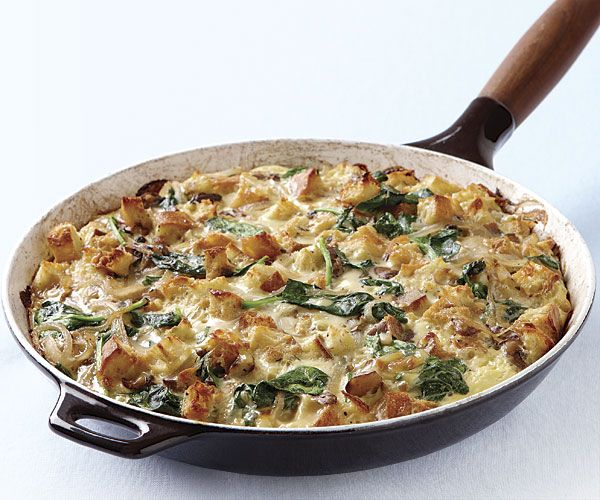 Mushroom and Spinach Skillet Strata - A strata is essentially a savory bread pudding. Here, smoked Gouda lends a hearty richness to the classic pairing of spinach and mushrooms. Serve with a lightly dressed salad to round out the meal. by Melissa Denchak from Fine Cooking Issue 125