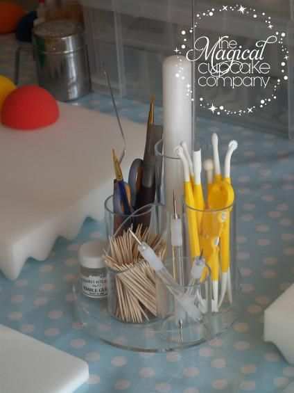 using a stationary stand for the many cake tools - @Diane Haan Lohmeyer Le Lievre