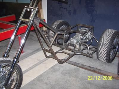 I had a guy come to me and ask me to build him a trike frame that could be vw powered but look like a chopper..so i took on the project..i started drawing