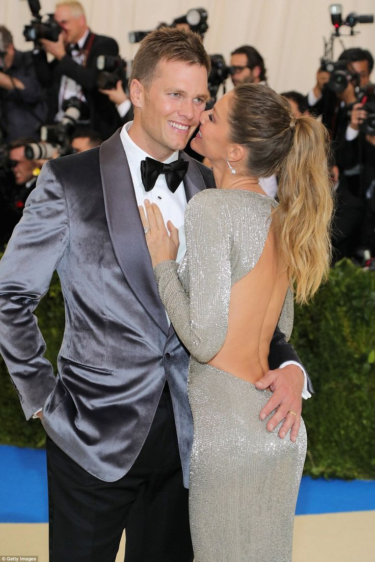 Ready to frock and roll! Gisele Bunchen kisses Tom Brady as she leads the arrivals at the Met Gala