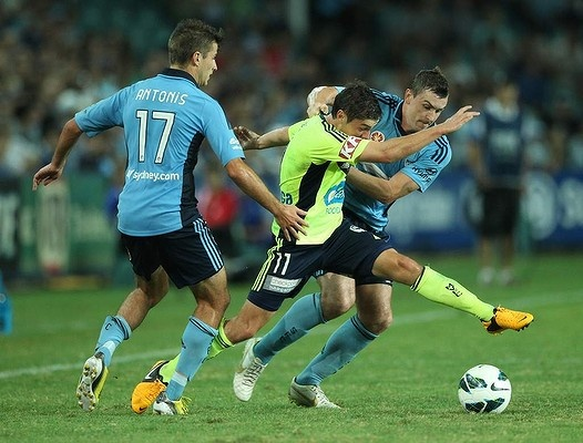 Sydney FC battle hard after going down a goal early by the Melbourne Victory