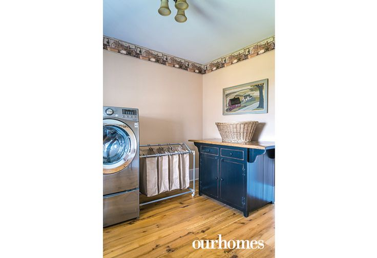 It made sense to locate the laundry near the bedrooms for the sake of convenience. See more: http://www.ourhomes.ca/articles/build/article/oldfashioned-range-fits-this-farmhouse-revival?full=true