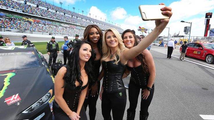 NASCAR fans in uproar over risque victory lane models  -  The Monster Energy girls pose for a selfie on Pit Road before the Clash at Daytona NASCAR race on Sunday, Feb. 19, 2017, at Daytona International Speedway in Daytona Beach, Fla.