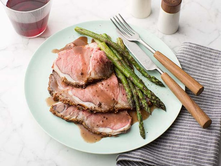 Prime Rib au Jus : Tender and juicy prime rib is topped with Sandra Lee's au jus reduction sauce that features Worcestershire and red wine. Pair with a vegetable side dish for any holiday meal.