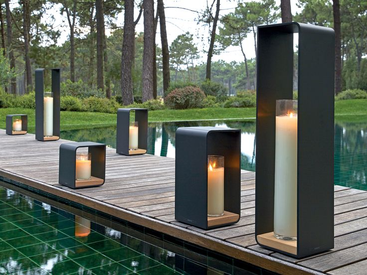 Available in powder-coated aluminium Lava & White, these elegant decorative elements with Iroko base can easily be combined to create striking and stylish arrangements. Play with the different candle heights and enjoy a warm and welcoming atmosphere in any outdoor space. #Manutti #outdoorcandleholder #Dawsonandco
