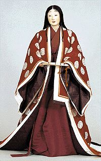 This is a Heian princess (hime)'s wedding dress.  It's from the Costume Museum website, but it only appears on the Japanese version of the site (a lot of the costumes never made it to the English version, for whatever reason.)    She's wearing maroon kosode and nagabakama, covered by the outer robes (from inside out): 1. hitoe, 2. koromo [note: this is the only ensemble I've seen with one- it's the white layer coat), 3. POSSIBLY some kinu (although it could be kouchigi linings) 4. Kouchigi