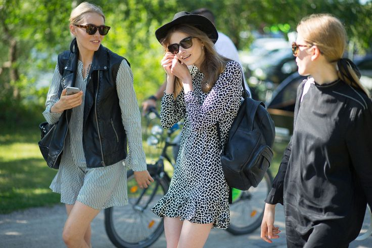 Far left: dress + vest  Girls and Bikes: Copenhagen Street Style  - HarpersBAZAAR.com