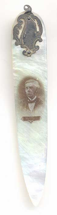 This bookmark was made in the US by an unknown manufacturer. It is made of mother-of-pearl and silver and had a red silk tassel on top. There is a photo of Oliver Wendell Holmes, Sr. on the blade. It was most likely used as a letter opener as well.