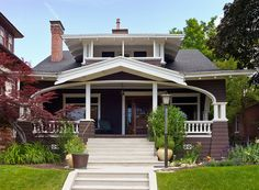 White Trim Craftsman Bungalow House with cool porch