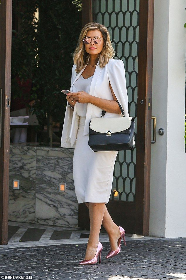 Jessica Wright.. Olcay Gulsen cape dress c/o Spotted On Celeb, Jessica Wright Footwear heels, and Zara tote..