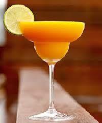 New Chapter. Lekkere cocktail met Grand Marnier, witte curacao, rum, limoen en mango. Nieuwe ronde, nieuwe kansen! Proost! Op de toekomst! Op het nieuw te beginnen hoofdstuk!