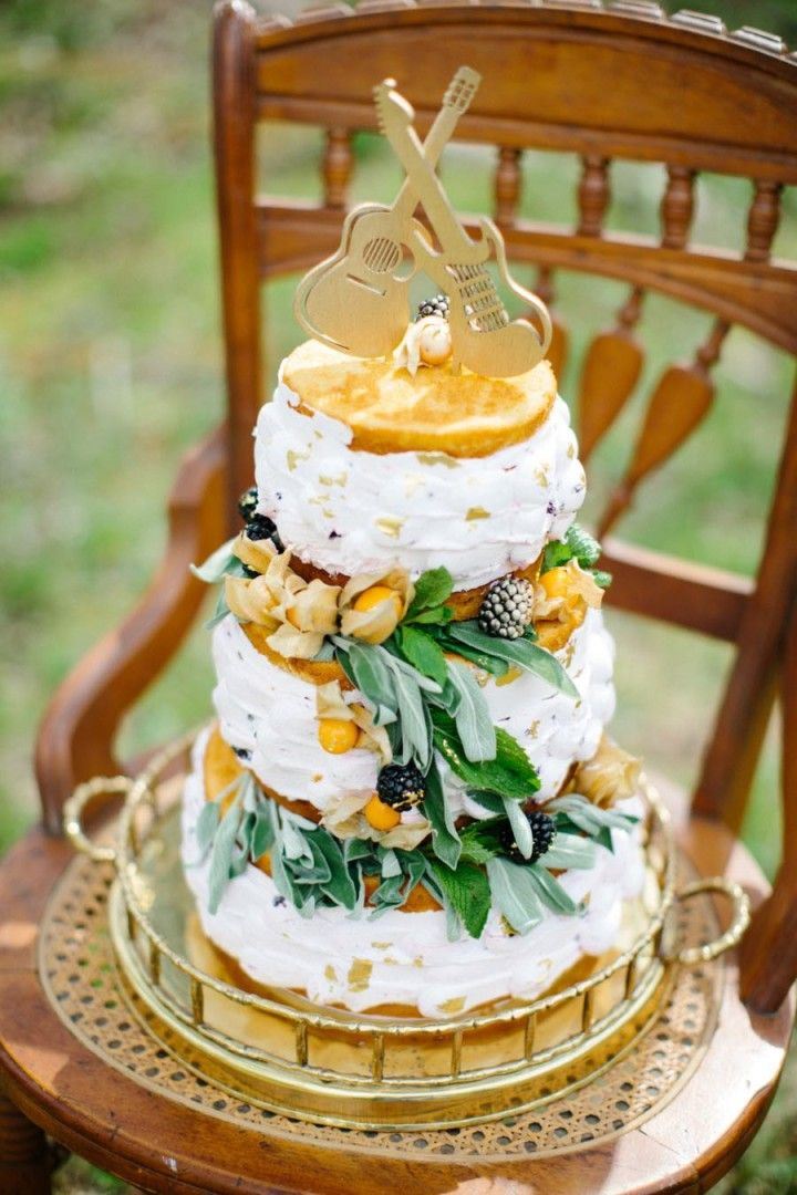 Fun guitar themed naked wedding cake with greenery and berries - MODwedding