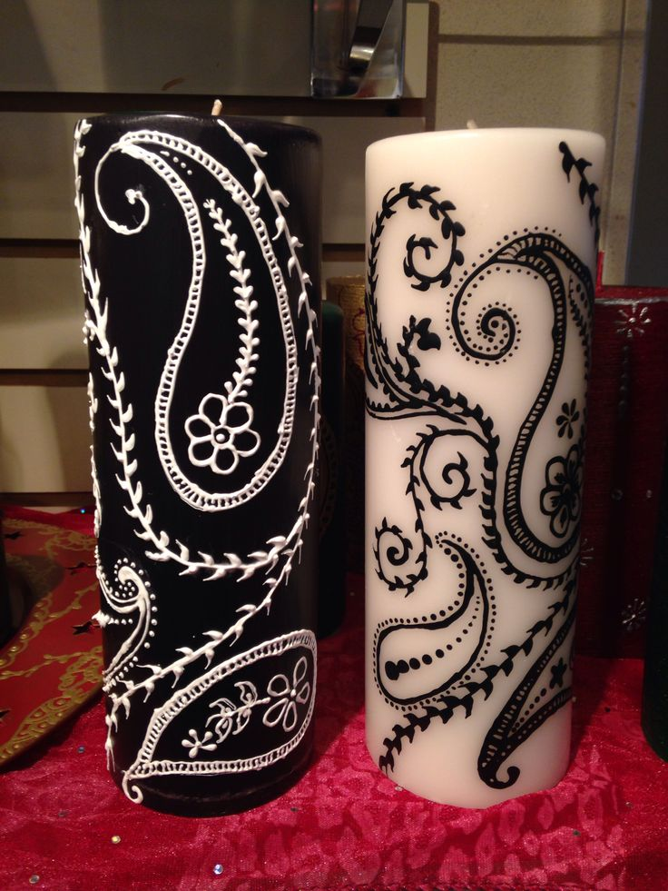 Black and white Henna art candles with intricate designs.
